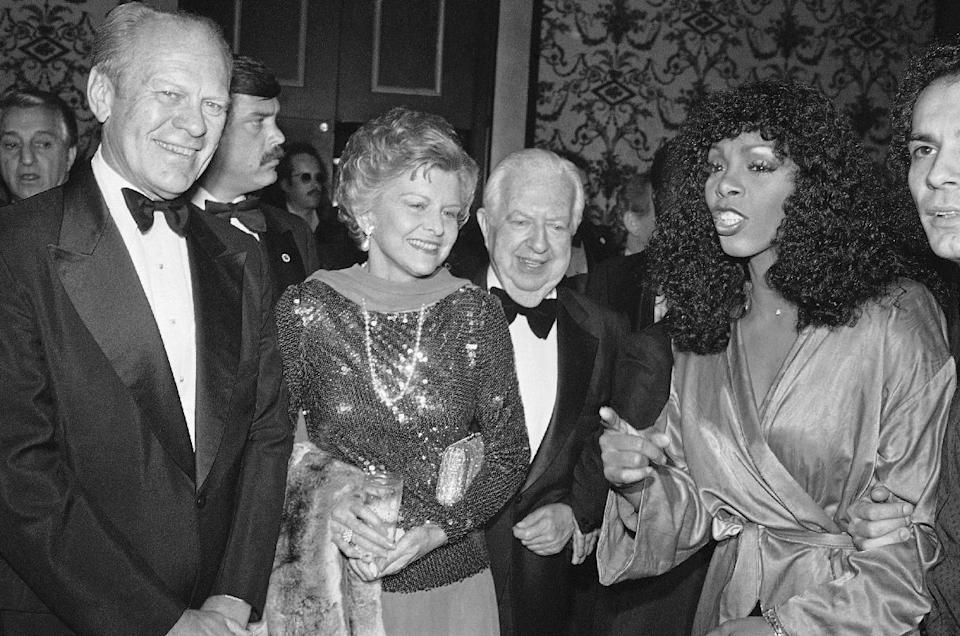 """FILE - In this Nov. 2, 1979 file photo, Gerald and Betty Ford, left, Donna Summer, right, and Cedars-Sinai Medical Center board chairman Steve Broidy at a reception prior to gala disco party benefit in Beverly Hills, Calif. Summer, the Queen of Disco who ruled the dance floors with anthems like """"Last Dance,"""" """"Love to Love You Baby"""" and """"Bad Girl,"""" has died. Her family released a statement, saying Summer died Thursday, May 17, 2012. She was 63. (AP Photo/Reed Saxon, File)"""