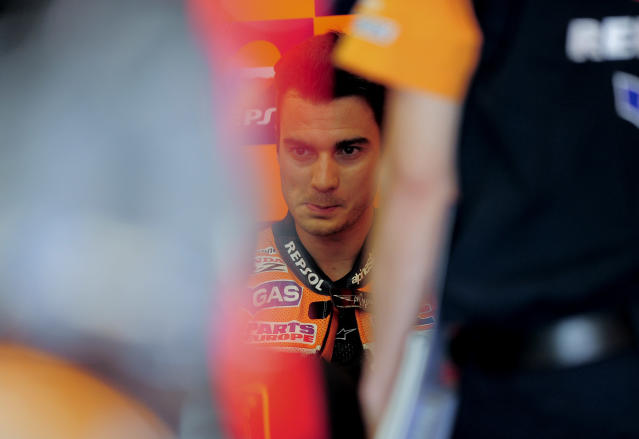 Repsol Honda Team's Spanish Dani Pedrosa speaks with his engineers in the pits at the Catalunya racetrack in Montmelo, near Barcelona, on June 2, 2012, during the MotoGP third training session of the Catalunya Moto GP Grand Prix. AFP PHOTO / JOSEP LAGOJOSEP LAGO/AFP/GettyImages