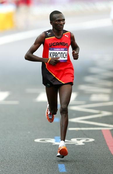 LONDON, ENGLAND - AUGUST 12:  Stephen Kiprotich of Uganda competes on his way to winning gold in the Men's Marathon on Day 16 of the London 2012 Olympic Games at The Mall on August 12, 2012 in London, England.  (Photo by Michael Steele/Getty Images)