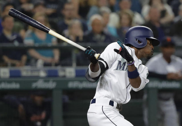 Seattle Mariners' Dee Gordon follows through on a two-run double during the sixth inning of the team's baseball game against the Detroit Tigers, Saturday, May 19, 2018, in Seattle. (AP Photo/Ted S. Warren)