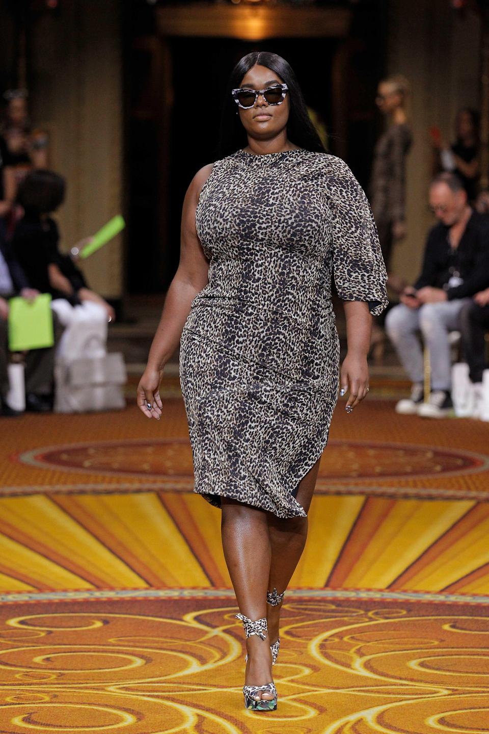 <p>A plus-size model walks Christian Siriano's runway wearing a leopard print dress, matching heels, and cat-eye sunglasses during New York Fashion Week. (Photo: Getty Images) </p>