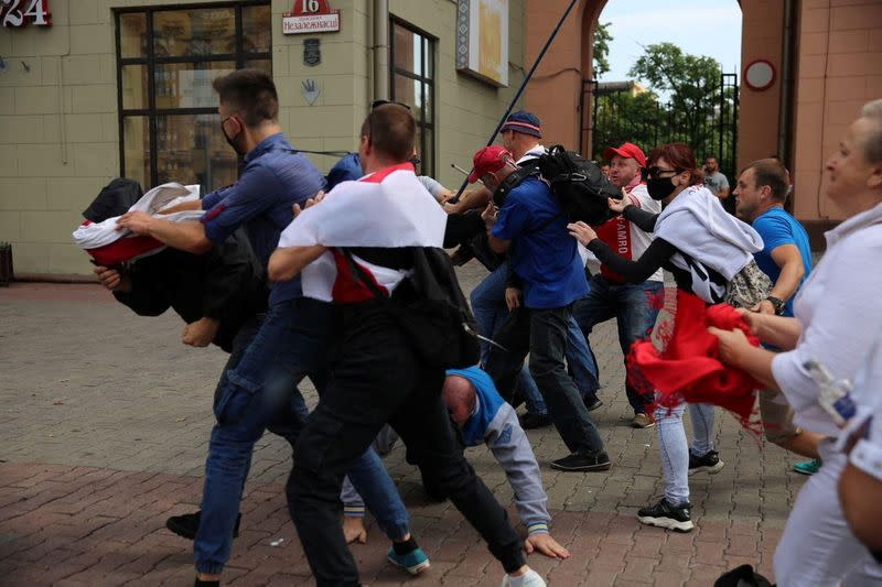 Protesters crowd Minsk as Belarus leader gets birthday call from Putin