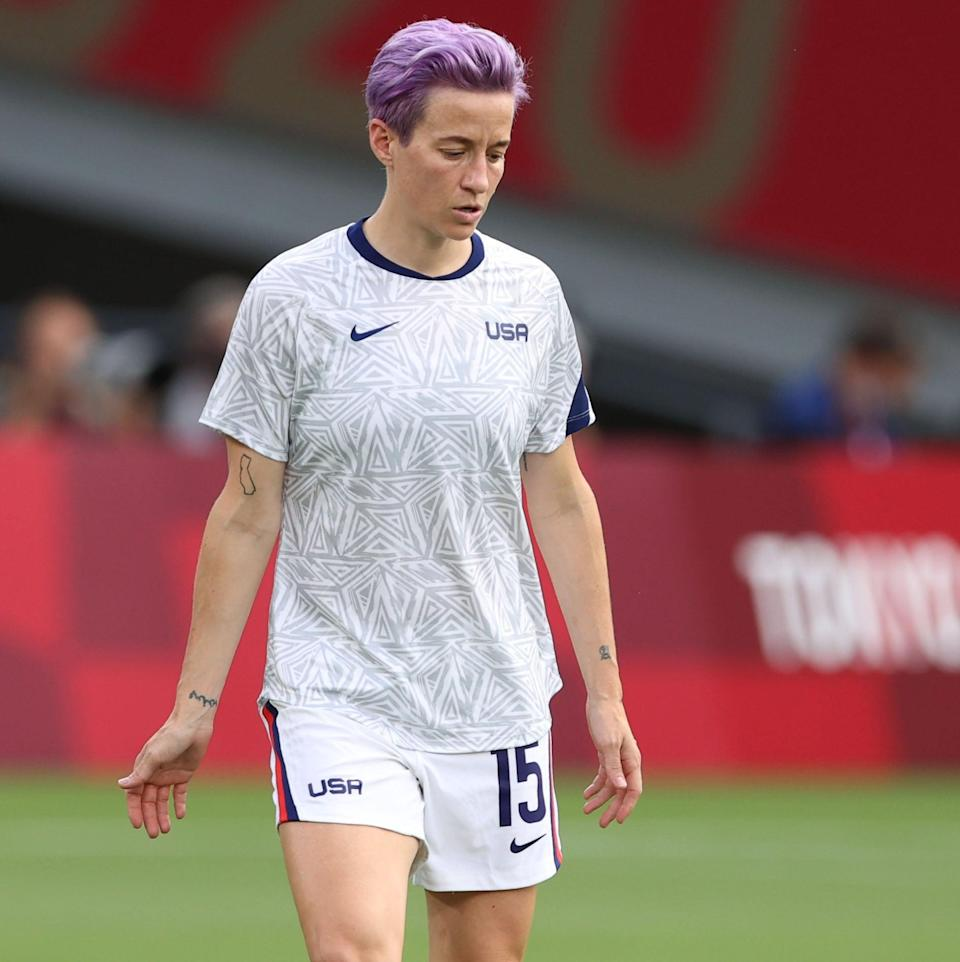 <p>On Rapinoe's left wrist is a small design in all-black ink. It's hard to make out what it is in photos, and she hasn't shared its meaning yet. </p>