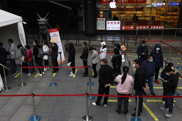 Residents are lined up to get the COVID-19 vaccine in the Beijing shopping district.