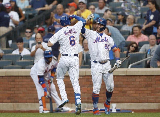 New York Mets' Jeff McNeil (6) celebrates with on-deck batter Pete Alonso (20) after hitting a solo home run during the first inning of the team's baseball game against the New York Yankees, Wednesday, July 3, 2019, in New York. (AP Photo/Kathy Willens)