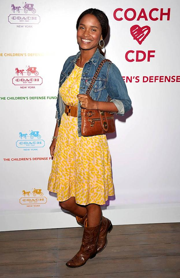 "Mixing high fashion with regular fare, Joy Bryant paired a Levi's jacket with a yellow print Tucker dress, Coach bag, and Ralph Lauren cowboy boots. John Shearer/<a href=""http://www.gettyimages.com/"" target=""new"">GettyImages.com</a> - April 20, 2011"