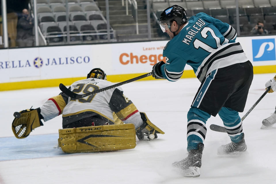 Vegas Golden Knights goaltender Marc-Andre Fleury, left, defends against a shot by San Jose Sharks center Patrick Marleau (12) during the first period of an NHL hockey game in San Jose, Calif., Wednesday, May 12, 2021. (AP Photo/Jeff Chiu)