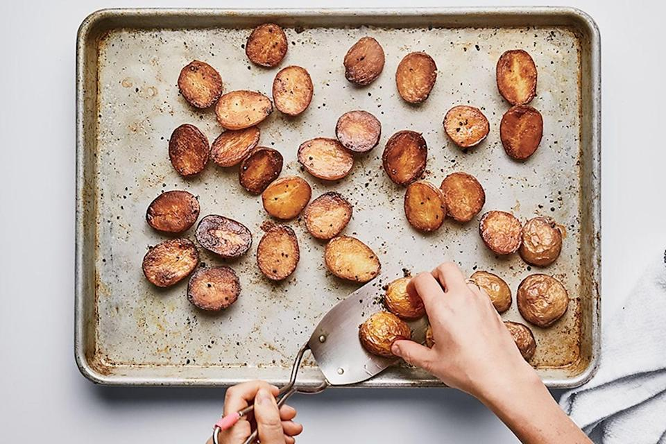 "You know what goes with pretty much everything? Crispy, creamy, perfectly roasted potatoes. The secret: Steam before you roast. <a href=""https://www.epicurious.com/recipes/food/views/perfectly-roasted-potatoes?mbid=synd_yahoo_rss"" rel=""nofollow noopener"" target=""_blank"" data-ylk=""slk:See recipe."" class=""link rapid-noclick-resp"">See recipe.</a>"