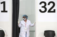 A nurse waits at a vaccination booth, in the center for vaccination against COVID-19, at A1 Arena in Skopje, North Macedonia, on Tuesday, May 4, 2021. The European Union started delivering EU-funded coronavirus vaccines Tuesday to the Balkans, a region that wants to join the 27-nation bloc but where China and Russia have already been supplying the much-needed shots and making political gains. (AP Photo/Boris Grdanoski)