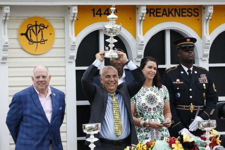 May 18, 2019; Baltimore, MD, USA; War of Will trainer Mark E. Casse holds the Woodlawn Vase in the Winner's Circle after the 144th running of the Preakness Stakes at Pimlico Race Course. Mandatory Credit: Geoff Burke-USA TODAY Sports