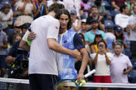 Lloyd Harris, right, of South Africa, is congratulated by Reilly Opelka, of the United States, after Harris won their match in the fourth round of the US Open tennis championships, Monday, Sept. 6, 2021, in New York. (AP Photo/Elise Amendola)