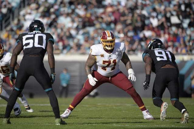 FILE - In this Dec. 16, 2018, file photo, Washington Redskins offensive tackle Trent Williams (71) sets up to block in front of Jacksonville Jaguars defensive end Yannick Ngakoue (91) during the second half of an NFL football game in Jacksonville, Fla. The San Francisco 49ers have acquired the seven-time Pro Bowl left tackle from the Redskins. Two people familiar with the deal said Saturday, April 25, 2020, the Niners will send a fifth-round pick in this year's draft and a 2021 third-rounder to acquire Williams. (AP Photo/Phelan M. Ebenhack, File)