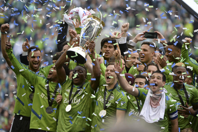 SEATTLE, WA - NOVEMBER 10: The Sounders celebrate on the podium after their 3-1 win over Toronto after the MLS Championship November 10, 2019, at Century Link Field in Seattle, WA. (Photo by Jeff Halstead/Icon Sportswire via Getty Images)
