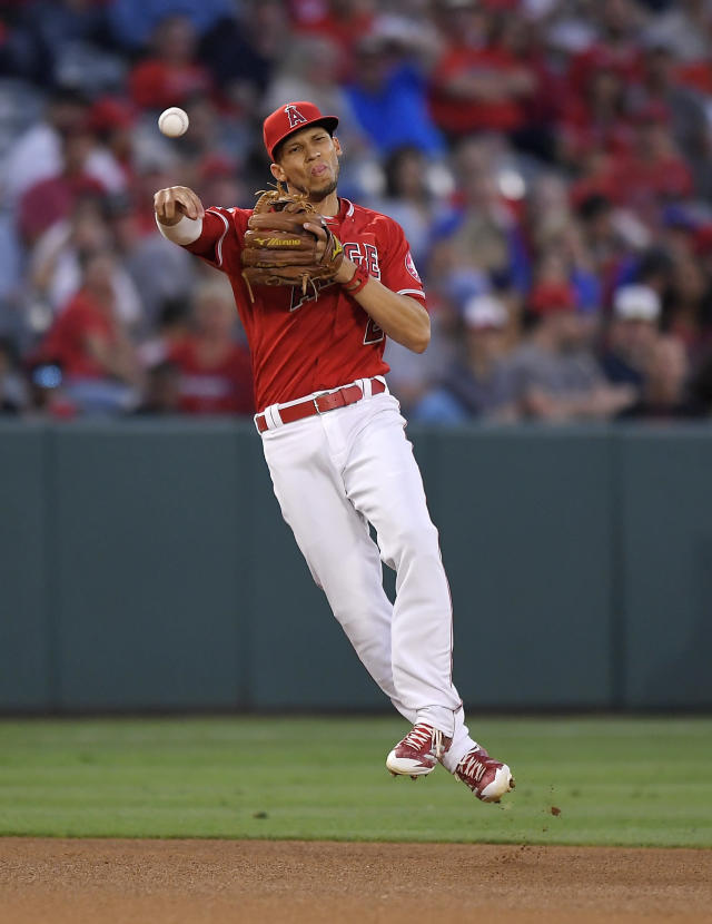 Los Angeles Angels shortstop Andrelton Simmons throws out Toronto Blue Jays' Kendrys Morales at second after fielding a ball hit by Kevin Pillar during the fourth inning of a baseball game Friday, June 22, 2018, in Anaheim, Calif. Pillar was also thrown out at first on the play. (AP Photo/Mark J. Terrill)