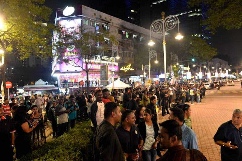 People gather for a rally in Brickfields, Kuala Lumpur August 23, 2019.