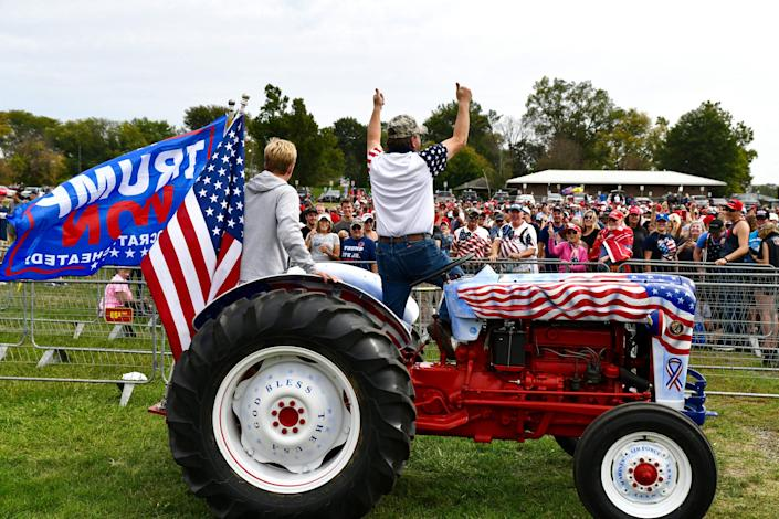 Gary Leffler, right, 60, of West Des Moines leads a chant for supporters who gathered early to see former President Donald Trump at the Iowa State Fairgrounds in Des Moines on Oct. 9, 2021.