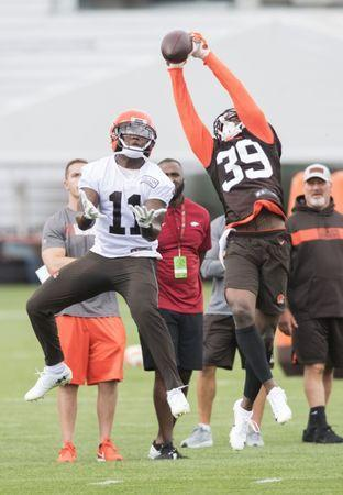 FILE PHOTO: Jul 27, 2018; Berea, OH, USA; Cleveland Browns defensive back Terrance Mitchell (39) intercepts a ball intended for wide receiver Antonio Callaway (11) during training camp at the Cleveland Browns Training Complex. Mandatory Credit: Ken Blaze-USA TODAY Sports