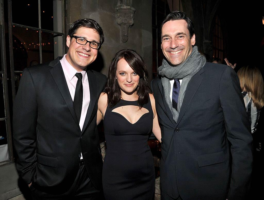 """Mad Men"" stars (L-R) Rich Sommer, Elisabeth Moss, and a chilly Jon Hamm donned modern-day fashions, rather than the '60s wardrobe we're used to seeing them in on the show. (11/17/2011)"