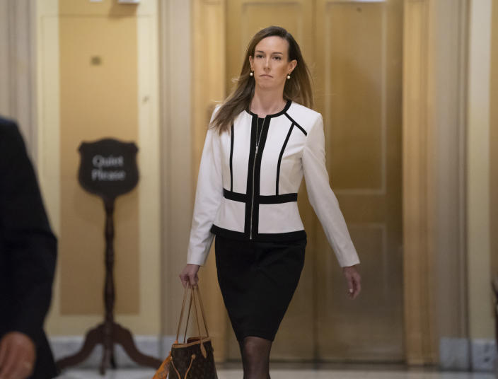 Jennifer Williams, a special adviser to Vice President Mike Pence for Europe and Russia who is a career Foreign Service officer, arrives for a closed-door interview in the impeachment inquiry on President Donald Trump's efforts to press Ukraine to investigate his political rival, Joe Biden, at the Capitol in Washington, Thursday, Nov. 7, 2019. (AP Photo/J. Scott Applewhite)