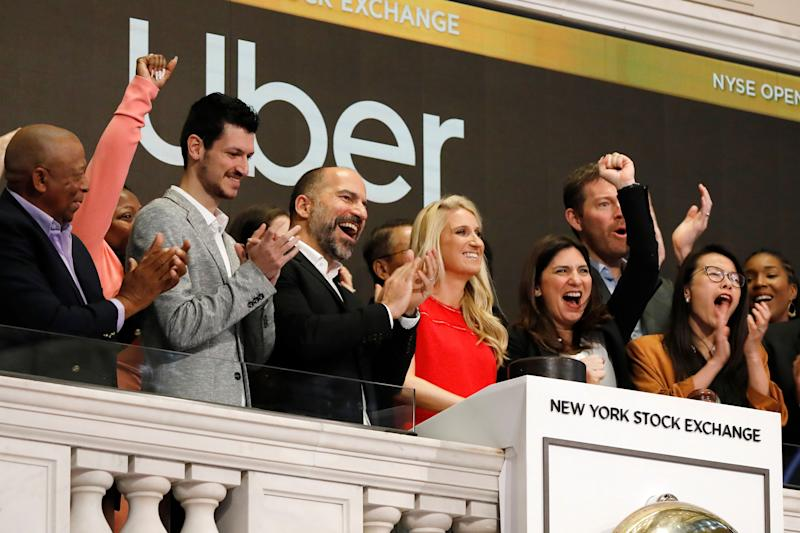 Uber CEO Dara Khosrowshahi, third from left, attends the opening bell ceremony at the New York Stock Exchange, as his company makes its initial public offering, Friday, May 10, 2019. (AP Photo/Richard Drew)