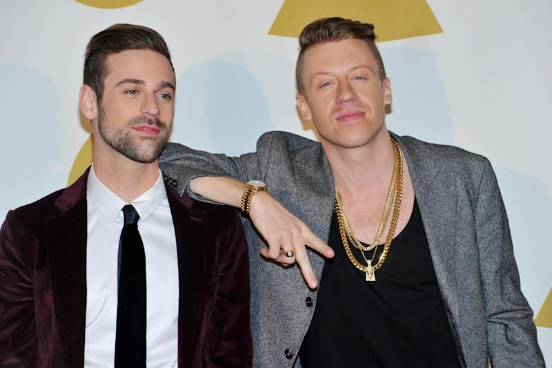 Ryan Lewis, left, and Macklemore pose backstage at the Grammy Nominations Concert Live! on Friday, Dec. 6, 2013, at the Nokia Theatre L.A. Live in Los Angeles. (Photo by Richard Shotwell/Invision/AP)