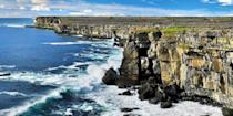 """<p>Off the western coast of <a href=""""https://www.bestproducts.com/fun-things-to-do/g3506/best-hotels-in-ireland/"""" rel=""""nofollow noopener"""" target=""""_blank"""" data-ylk=""""slk:Ireland"""" class=""""link rapid-noclick-resp"""">Ireland</a>, the Aran Islands are a remote trio of islands in the Atlantic. The largest island, Inishmore, is famous for its prehistoric <a href=""""https://go.redirectingat.com?id=74968X1596630&url=https%3A%2F%2Fwww.tripadvisor.com%2FShowUserReviews-g551521-d564755-r175611804-Dun_Aonghasa-Inishmore_Aran_Islands_County_Galway_Western_Ireland.html&sref=https%3A%2F%2Fwww.redbookmag.com%2Flife%2Fg36983737%2Fmost-beautiful-islands-in-the-world%2F"""" rel=""""nofollow noopener"""" target=""""_blank"""" data-ylk=""""slk:ring fort"""" class=""""link rapid-noclick-resp"""">ring fort</a> (perched atop a 300-foot cliff) and <a href=""""https://go.redirectingat.com?id=74968X1596630&url=https%3A%2F%2Fwww.tripadvisor.com%2FRestaurant_Review-g551521-d1640133-Reviews-Joe_Watty_s_Bar-Inishmore_Aran_Islands_County_Galway_Western_Ireland.html&sref=https%3A%2F%2Fwww.redbookmag.com%2Flife%2Fg36983737%2Fmost-beautiful-islands-in-the-world%2F"""" rel=""""nofollow noopener"""" target=""""_blank"""" data-ylk=""""slk:Ti Joe Watty's"""" class=""""link rapid-noclick-resp"""">Ti Joe Watty's</a> pub, which is a hub for seafood, Guinness, and live Celtic music. </p>"""