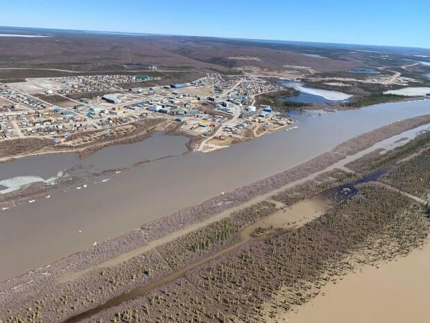 An aerial view of Inuvik, N.W.T., on  June 1, 2020. A scientist with Natural Resources Canada says the water levels are the highest he has seen in 17 years of recorded data.
