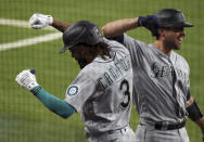 Seattle Mariners' J.P. Crawford (3) celebrates his fourth-inning, two-run home run with Tom Murphy against the Texas Rangers during a baseball game Friday, May 7, 2021, in Arlington, Texas. (AP Photo/Richard W. Rodriguez)