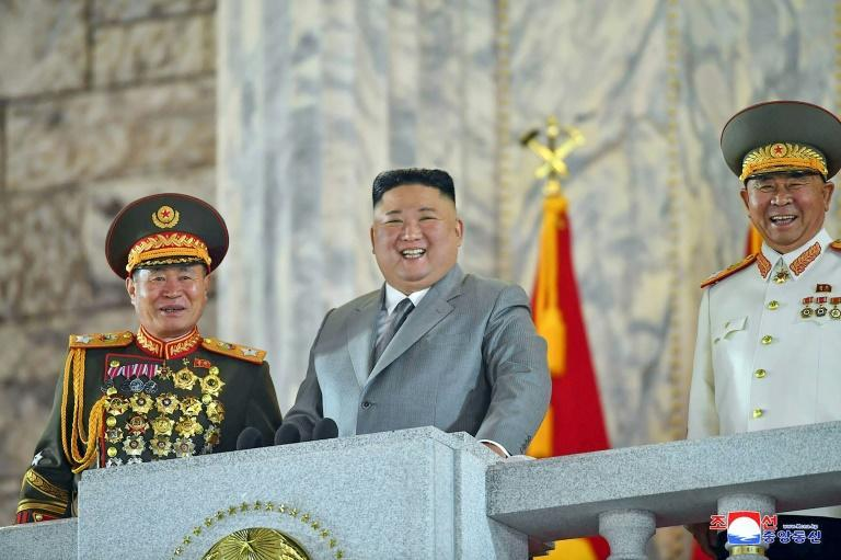 North Korean leader Kim Jong Un presides over an October 10, 2020 military parade in which Pyongyang showcased a new long-range missile that has alarmed the United States