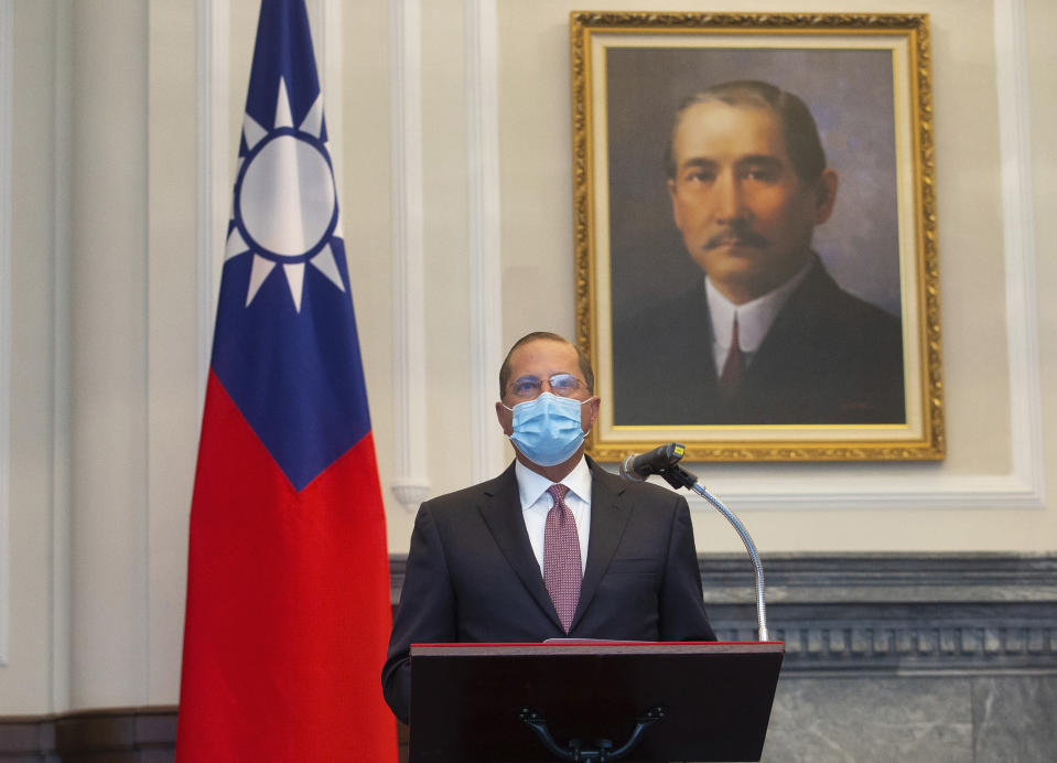 U.S. Health and Human Services Secretary Alex Azar speaks during a meeting with Taiwan's President Tsai Ing-wen, unseen, in front of a portrait of Sun Yat-sen, who is widely regarded as the founding father of modern China, in Taipei, Taiwan, Monday, Aug. 10, 2020. Azar arrived in Taiwan on Sunday in the highest-level visit by an American Cabinet official since the break in formal diplomatic relations between Washington and Taipei in 1979. (Central News Agency Pool via AP Photo)