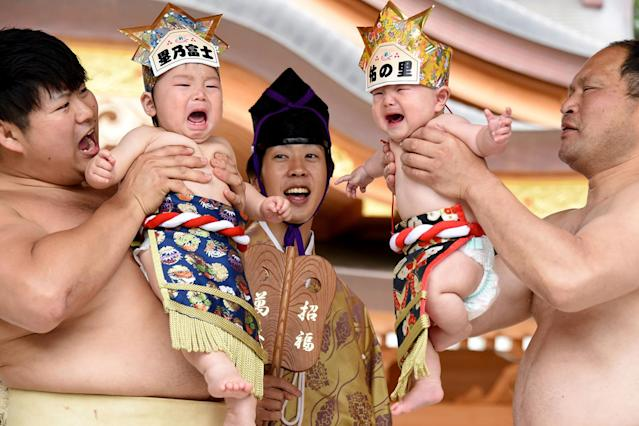"<p>Sumo wrestlers hold up crying babies in front of a referee during a ""Baby-cry Sumo"" event at the Kamegaike-Hachiman Shrine in Sagamihara, Kanagawa prefecture, Japan, May 14, 2017. (Photo: Toru Yamanaka/AFP/Getty Images) </p>"
