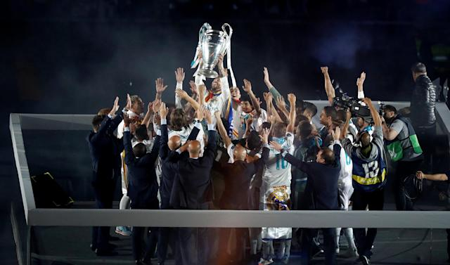 Soccer Football - Real Madrid celebrate winning the Champions League Final - Santiago Bernabeu, Madrid, Spain - May 27, 2018 Real Madrid players celebrate with the trophy during the victory celebrations REUTERS/Javier Barbancho