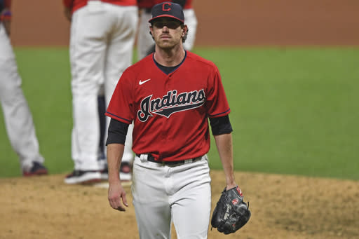 Cleveland Indians starting pitcher Shane Bieber (57) walks to the dugout after being removed from the game in the fifth inning of Game 1 of an American League wild-card baseball series against the New York Yankees, Tuesday, Sept. 29, 2020, in Cleveland. (AP Photo/David Dermer)