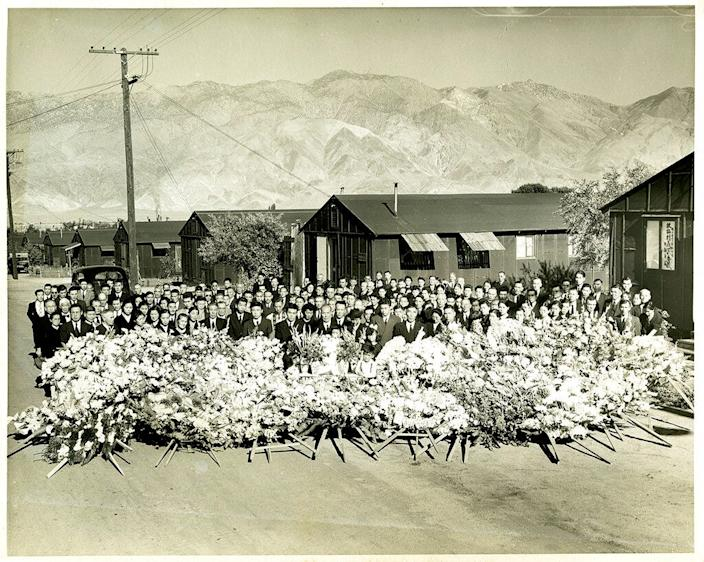 This 1945 photo provided by the Toyo Miyatake Studio shows a memorial service for Giichi Matsumura, who died on nearby Mount Williamson during his incarceration at an internment camp for people of Japanese ancestry in Manzanar, Calif., during World War II.