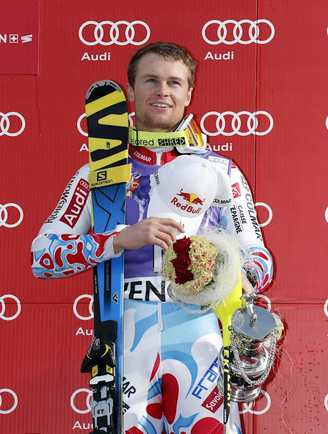 France's Alexis Pinturault poses on the podium after winning an alpine ski, men's World Cup slalom, in Wengen, Switzerland, Sunday, Jan. 19, 2014. Alexis Pinturault of France soared from seventh place after the first run to win a World Cup slalom on Sunday. Pinturault was almost a half-second faster than everyone else in the afternoon to finish 0.34 ahead of Felix Neureuther of Germany. (AP Photo/Shinichiro Tanaka)