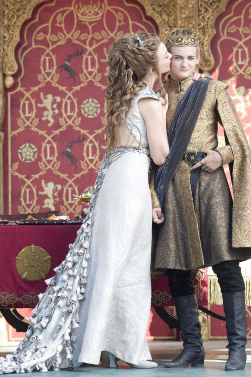 <p>While I have some *major* issues with the guy Margaery Tyrell is marrying here (yikes, girl, don't do it!), I have no complaints about her pretty wedding dress, complete with a train of roses, which is a sweet tribute to her Highgarden upbringing. </p>