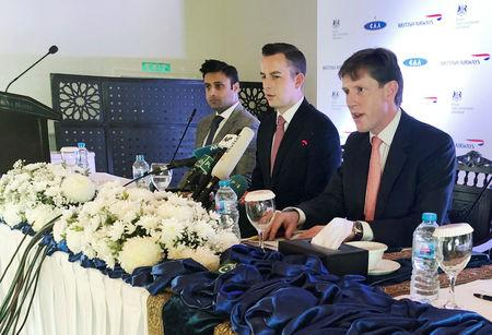 Richard Crowder (R), Deputy British High Commissioner to Pakistan, delivers a news conference along with Robert Williams (C), head of the sales for Asia Pacific and the Middle East for British Airways and Zulfi Bukhari, special assistant on overseas Pakistanis and human resource development, in Islamabad, Pakistan December 18, 2018. REUTERS/Drazen Jorgic
