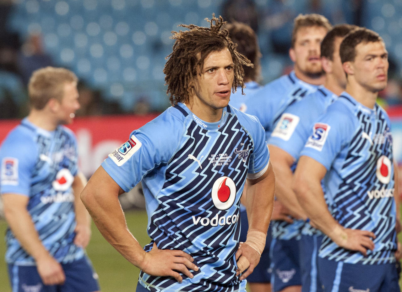 South Africa's Bulls Zane Kirchner, center, with teammates dejected at the end of their Super Rugby semi final match against Australia's Brumbies at Loftus Versfeld Stadium in Pretoria, South Africa, Saturday July 27, 2013. Brumbies beat Bulls 26-23. (AP Photo/Themba Hadebe)