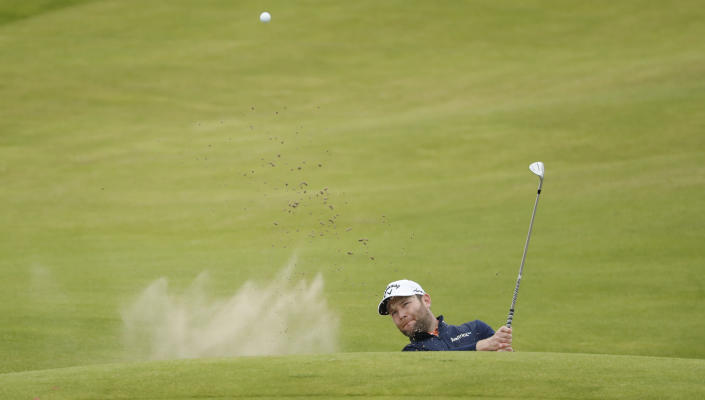 South Africa's Branden Grace plays out of a bunker on the 2nd hole during a practice round for the British Open Golf Championship at Royal St George's golf course Sandwich, England, Wednesday, July 14, 2021. The Open starts Thursday, July, 15. (AP Photo/Peter Morrison)