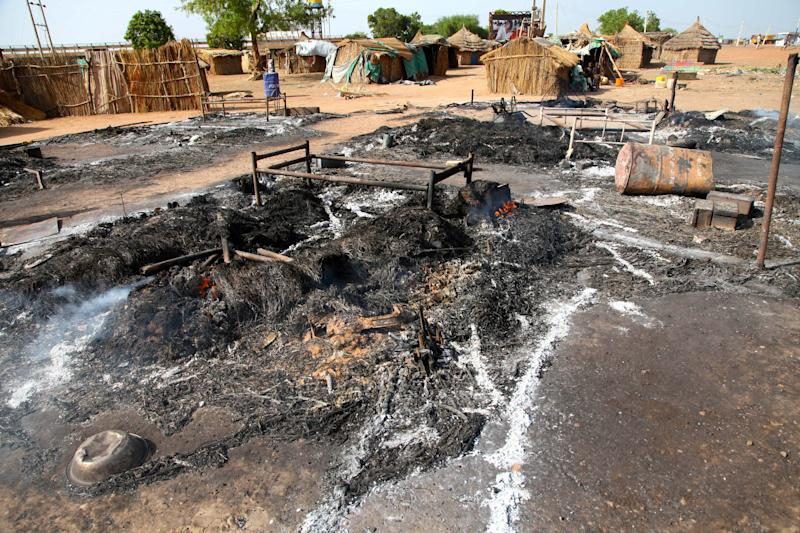 This photo of Saturday, April 14, 2012, shows the aftermath of a bombing by the Sudanese Air Force in Bentiu, South Sudan. Two Sudanese Sukhoi fighters dropped 6 bombs in the Bentiu area, killing five and wounding four others. Sudan and the newly formed South Sudan continued to battle Monday April 16 2012 over a disputed oil rich border area. (AP Photo/Michael Onyiego)