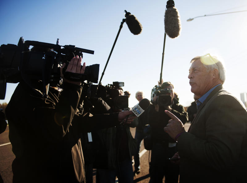 Bill Ferguson, right, speaks with members of the media about his his son's pending release from prison on Tuesday, Nov. 12, 2013 near the Jefferson City Correctional Center in Jefferson City, Mo. The Missouri attorney general said Tuesday that he won't seek to retry Ferguson's son whose 2005 murder conviction and 40-year prison sentence in the slaying of a newspaper sports editor were recently overturned. (AP Photo/Columbia Daily Tribune/Nick Schnelle)