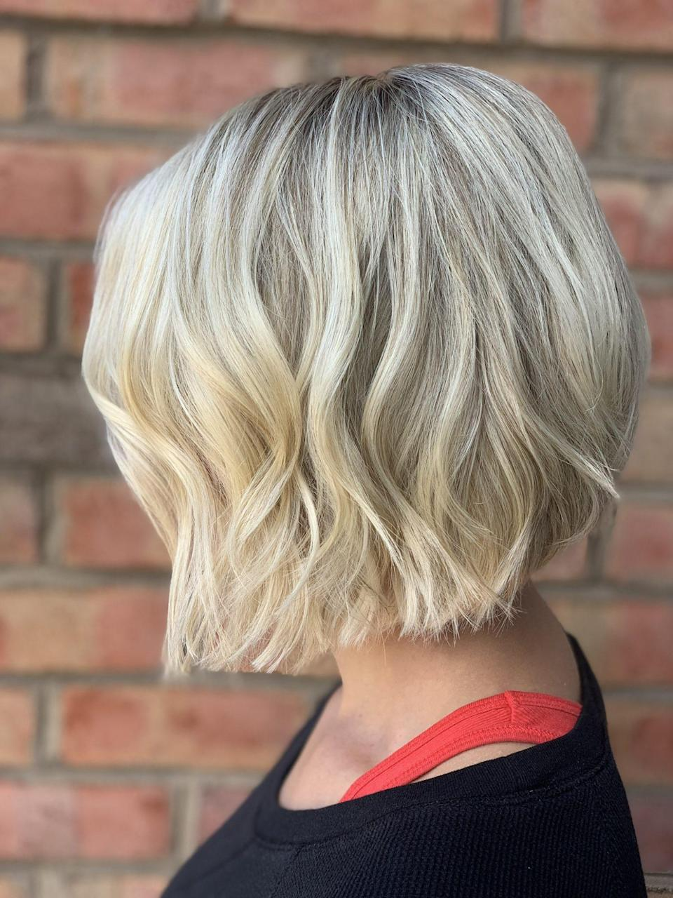 """<p>You can also accomplish a timeless look through the styling techniques you use. This bob cut has textured layers and is <a href=""""https://www.southernliving.com/fashion-beauty/hairstyles/best-curling-iron-short-hair"""" rel=""""nofollow noopener"""" target=""""_blank"""" data-ylk=""""slk:curled"""" class=""""link rapid-noclick-resp"""">curled</a> to accomplish an effortless """"beach wave"""" look. When blow drying your hair, always remember that the flatter the brush, the flatter your hair will appear, Janna Wright says. """"Using a round brush will give you more volume and height for your desired look."""" </p>"""