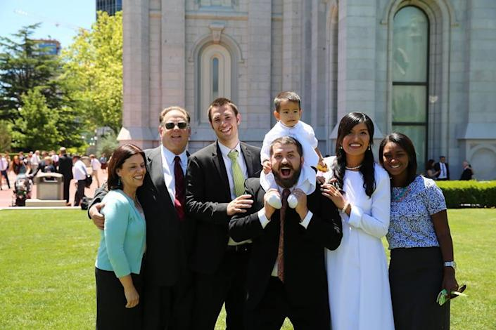 Jacob IsBell's mother, Emily; father, Michael; youngest brother, Travis; Jacob IsBell with his son, Jojo, on his shoulders; wife, Kat; and sister-in-law Angelica (from the Dominican Republic). (Courtesy Jacob IsBell)