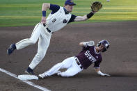 Notre Dame infielder Jack Brannigan (9) moves toward the ball as Mississippi State's Scott Dubrule, bottom, safely steals third base at an NCAA college baseball super regional game, Monday, June 14, 2021, in Starkville, Miss. (AP Photo/Rogelio V. Solis)