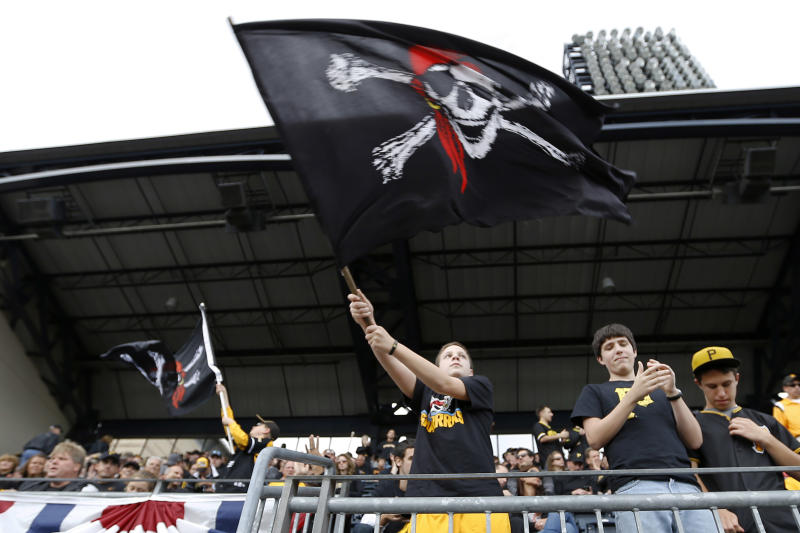 Pittsburgh Pirates fans wave Jolly Roger flags during the introductions of the Pittsburgh Pirates before Game 4 of a National League baseball division series against the St. Louis Cardinals on Monday, Oct. 7, 2013, in Pittsburgh. (AP Photo/Keith Srakocic)