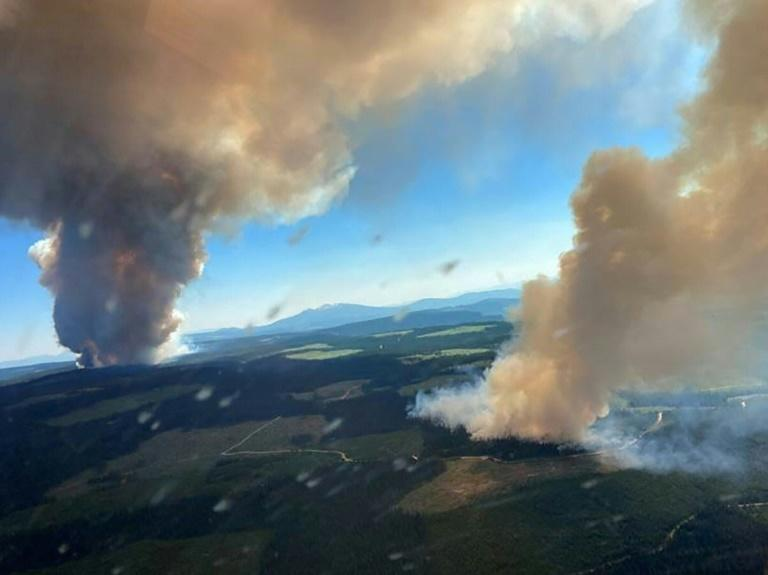 This handout photo courtesy of BC Wildfire Service shows two plumes of smoke from the Long Loch wildfire and the Derrickson Lake wildfire, British Columbia, on June 30, 2021