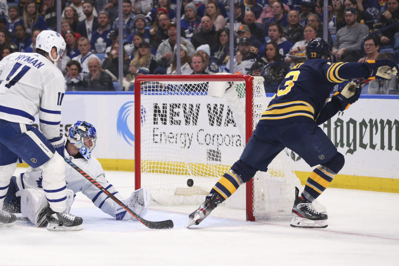 Buffalo Sabres forward Jimmy Vesey (13) puts the puck past Toronto Maple Leafs goalie Frederik Anderson (31) during the third period of an NHL hockey game Sunday, Feb. 16, 2020, in Buffalo, N.Y. (AP Photo/Jeffrey T. Barnes)