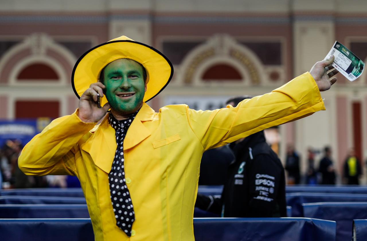 A fan dresses up as The Mask for the darts. (Photo by Steven Paston/PA Images via Getty Images)