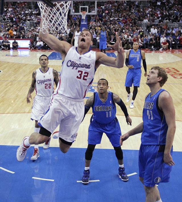Los Angeles Clippers' Blake Griffin (32) goes up for a dunk as Dallas Mavericks' Dirk Nowitzki (41) and Monta Ellis (11) watch during the first half of an NBA basketball game on Thursday, April 3, 2014, in Los Angeles. (AP Photo/Jae C. Hong)