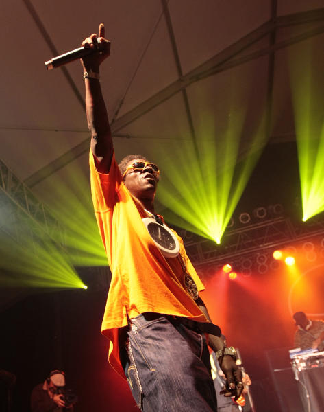FILE - In this June 12, 2009 file photo, Flavor Flav of Public Enemy performs during the Bonnaroo Arts and Music Festival in Manchester, Tenn. Public Enemy is nominated for induction into the Rock and Roll Hall of Fame in 2013. (AP Photo/Dave Martin, File)